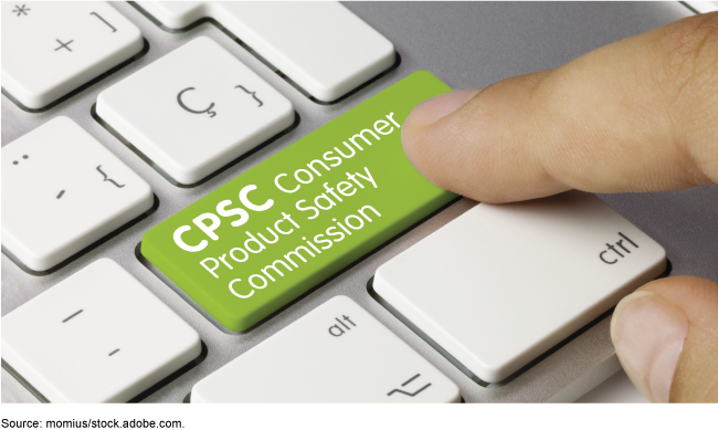 "Close up of a person's hand pressing a button on a computer keyboard that says, ""Consumer Product Safety Commission"""
