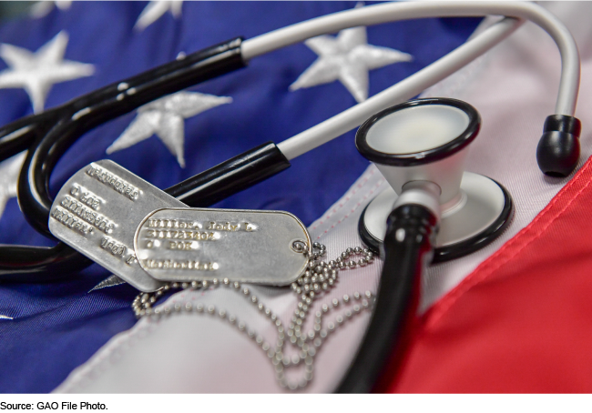 Military IDs and a stethoscope resting on an American Flag.