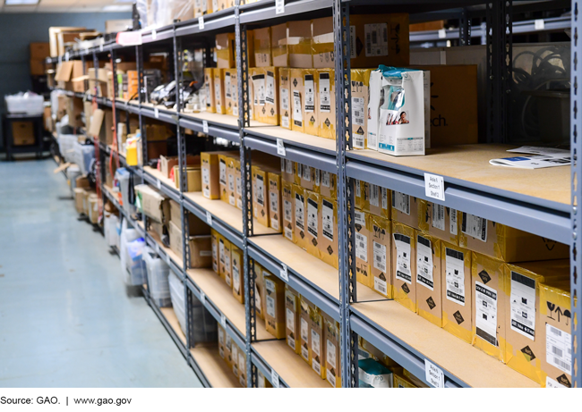 Photograph of boxed items on shelves in a mail facility.