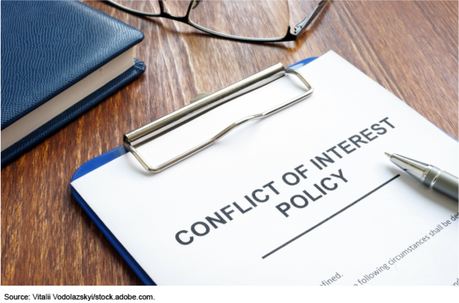 conflict of interest policy on a clipboard