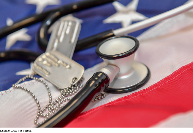 Military IDs and a stethoscope resting on an American flag