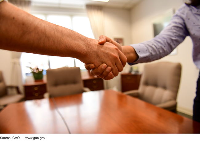 This is a photo of two hands in a handshake.