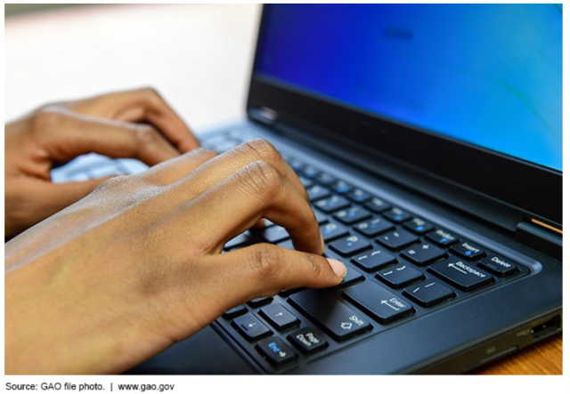 Photo Showing Someone Typing on a Laptop